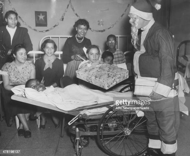 Christmas at Freedmen's Hospital pediatric unit Washington DC December 25 1948 Pictured are George Bryant in wheel chair from left Winfred Corbin...