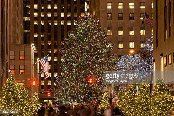 christmas at the rockefeller center from 48th st - rockefeller center stock pictures, royalty-free photos & images