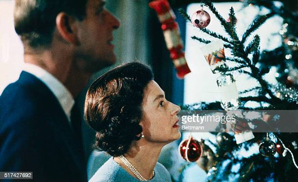 Christmas at Windsor Castle is shown here with Queen Elizabeth II and Prince Philip shown putting finishing touches to Christmas tree in a photo made...