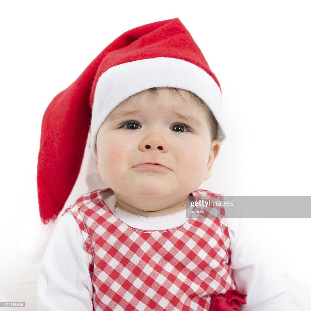 Christmas Baby Girl Wearing A Santa Hat Looking Sad Stock -2534