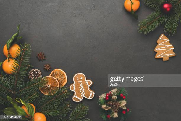 christmas background. fir tree, gingerbread cookies, tangerines - christmas cookies stock pictures, royalty-free photos & images