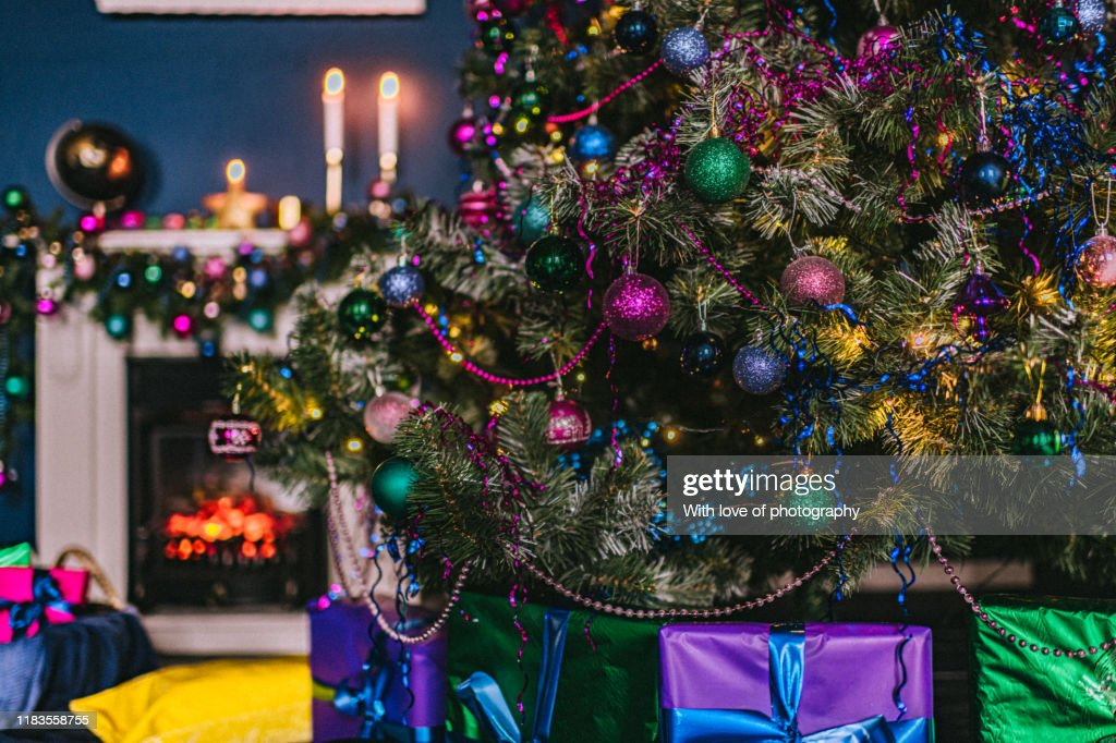 Christmas Background Lights Blue And Magenta Colored Christmas Decoration New Year Decoration Yellow And Green Colors Fur Tree Christmas Tree High Res Stock Photo Getty Images