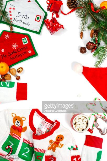 christmas background. ugly christmas sweater, letter to santa, cristmas decoration and cup of hot chocolate. - ugly santa stock photos and pictures