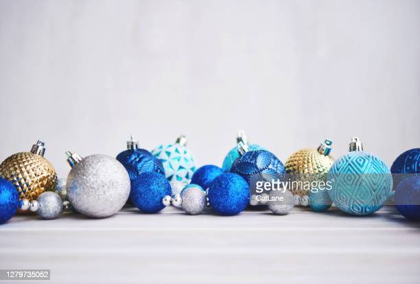 christmas background with blue silver and gold ornaments - royal blue background stock pictures, royalty-free photos & images