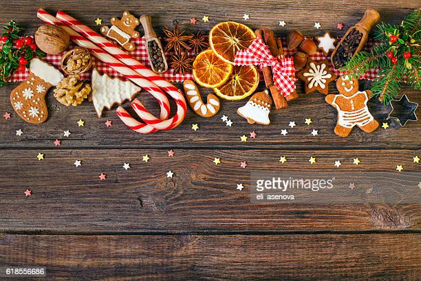 christmas background with christmas cookies, decoration and spices - nut food stock photos and pictures
