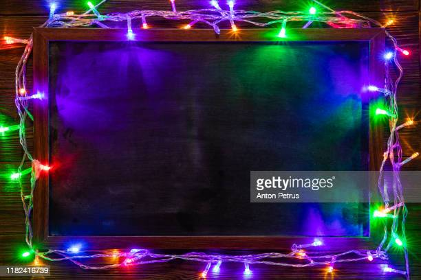 christmas background with christmas decorations and garland. - christmas garland stock pictures, royalty-free photos & images