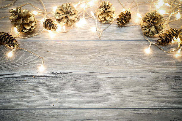 Christmas Background With Cones On Wooden Table