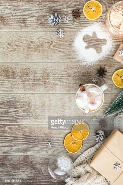 christmas background with decorations and gift boxes on wooden table - ramo parte della pianta foto e immagini stock