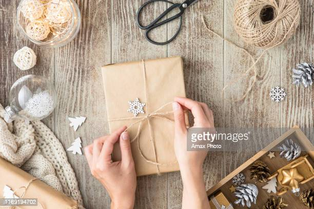 christmas background with decorations and gift boxes on wooden table - christmas banner stock photos and pictures