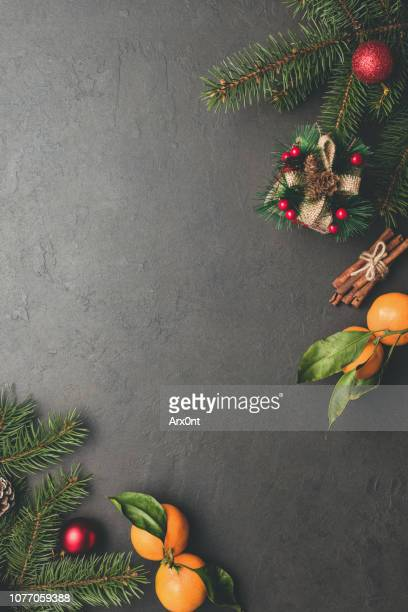 Christmas background with fir tree on black concrete