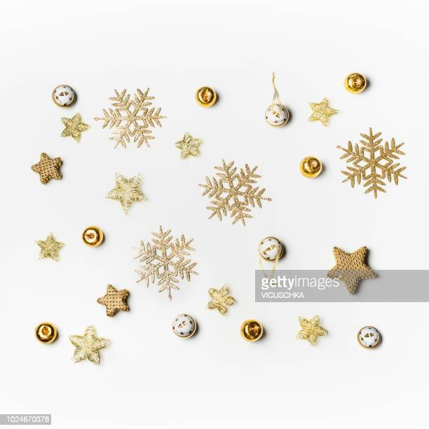 christmas background with gold snowflakes on white - flat lay stock pictures, royalty-free photos & images
