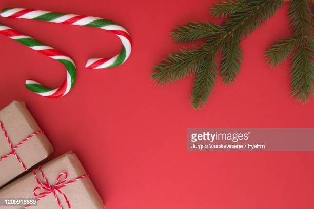christmas background with xmas decorations, gifts and candy canes. top view, flat lay - candy cane stock pictures, royalty-free photos & images