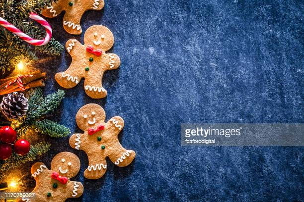 christmas backgrounds: homemade gingerbread cookies border with copy space. - christmas wallpaper stock pictures, royalty-free photos & images