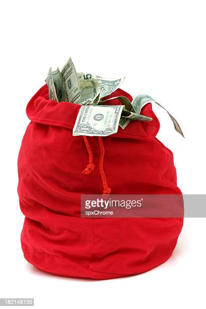 christmas bag full of money - money bag stock photos and pictures