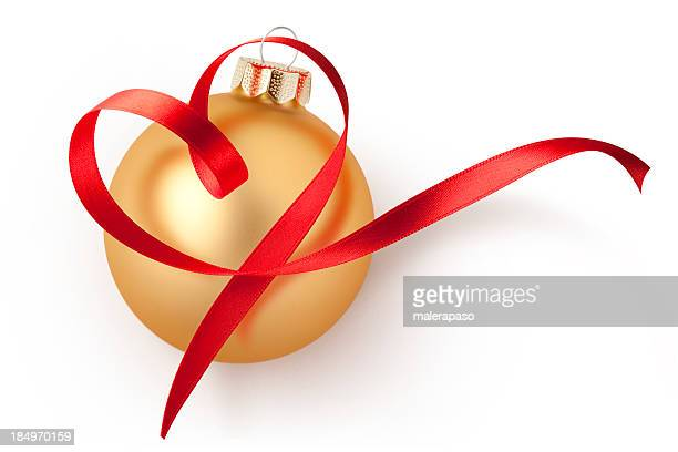 Christmas ball with red ribbon in heart shape