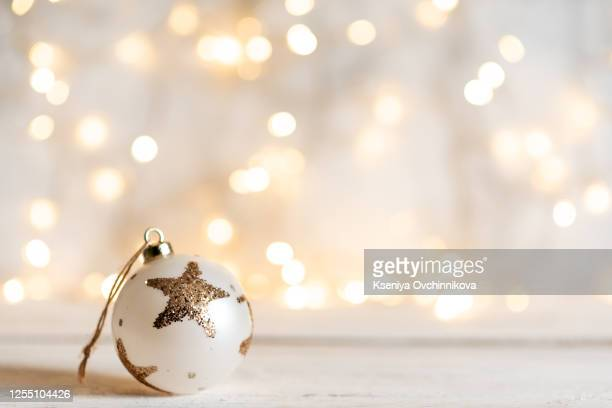 christmas balls before a twinkle background - star shape stock pictures, royalty-free photos & images