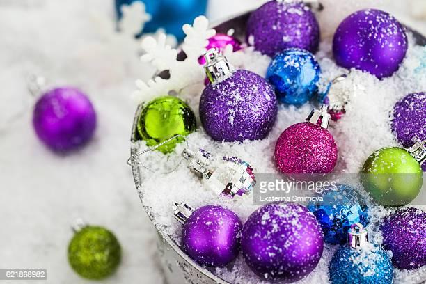 christmas balls in snow covered bucket - happy new month - fotografias e filmes do acervo