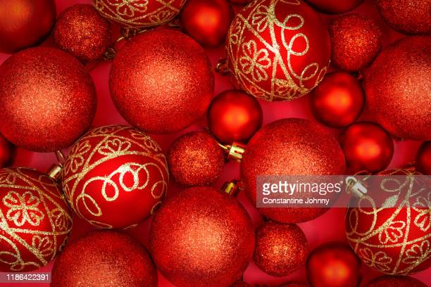 christmas balls on red background - hello december stock pictures, royalty-free photos & images
