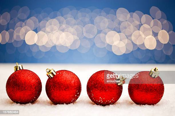 Christmas balls on snow with  lights background