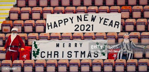 Christmas banners in the stand during a Betfred Cup quarter final match between Dunfermline Athletic and St Johnstone at East End Park, on December...