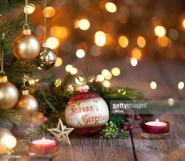 christmas bauble and gold lights background - hello december stock pictures, royalty-free photos & images