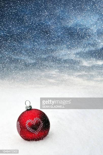 christmas bauble decoration in snow - country christmas stock pictures, royalty-free photos & images