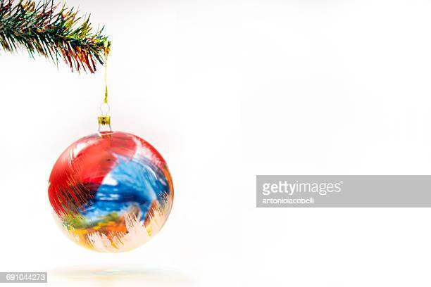 Christmas bauble hanging on a Christmas tree