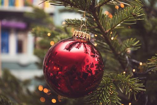 Christmas Bauble hanging on Christmas tree - gettyimageskorea