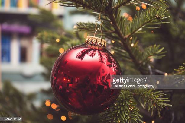 christmas bauble hanging on christmas tree - christmas ornaments stock photos and pictures