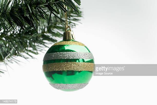 Christmas bauble hanging on tree