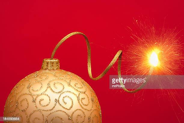 christmas bauble with gold touch paper - fuse stock photos and pictures