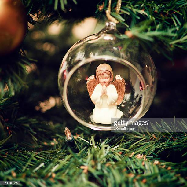 christmas bauble with praying angel - angel stock pictures, royalty-free photos & images