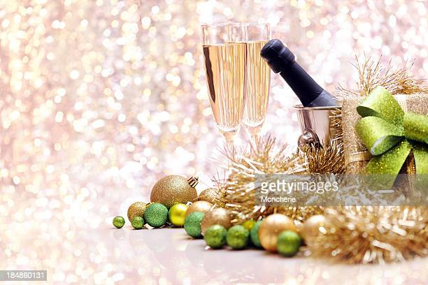 Christmas baubles and champagne with copy space