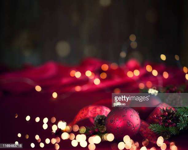 christmas baubles background - focus on foreground stock pictures, royalty-free photos & images