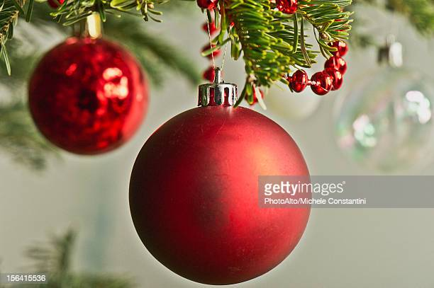 Christmas baubles hanging from Christmas tree