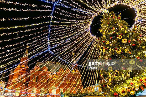 Christmas baubles hanging in tree on Manezhnaya square,Moscow,Russia