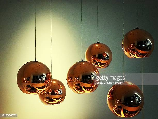 Christmas Baubles Hanging Over Colored Background
