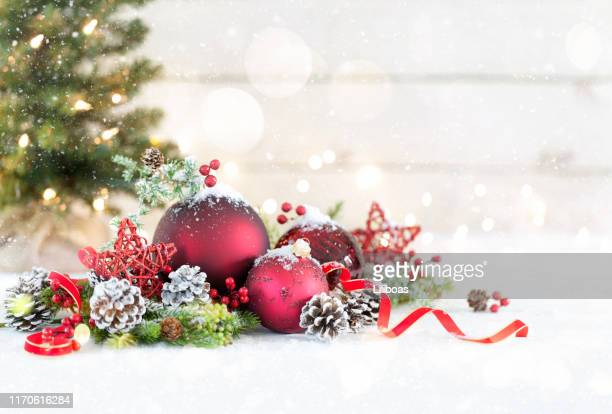 christmas baubles on a white wood background - christmas wallpaper stock pictures, royalty-free photos & images
