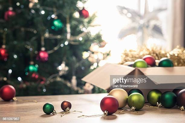 christmas baubles on table - christmas decoration stock pictures, royalty-free photos & images