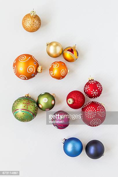 christmas baubles on white background - christmas ornaments stock photos and pictures