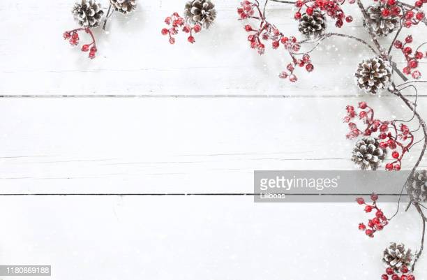 christmas berry garland border on an old white wood background - winter stock pictures, royalty-free photos & images