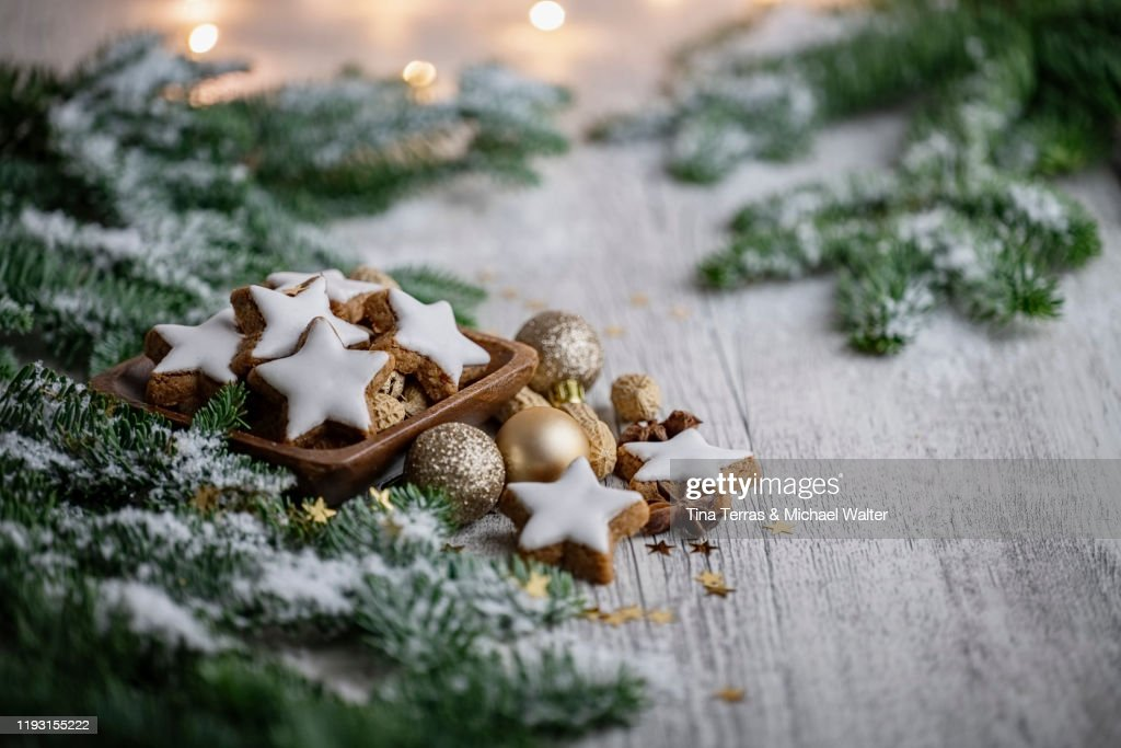 Christmas Biscuits On White Wood Background With Fir Green And Fairy Lights Christmas Mood High Res Stock Photo Getty Images
