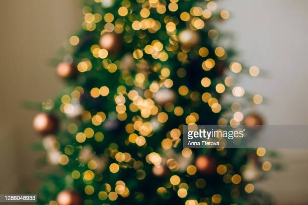 christmas blurred background made with decorated fir tree. concept of celebrating new year. - holiday stock pictures, royalty-free photos & images
