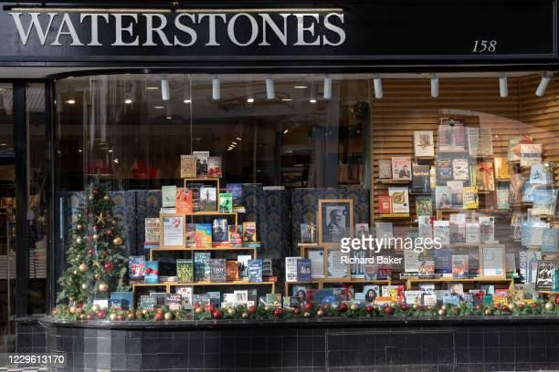 Christmas books stock in the window of a closed Chelsea branch of Waterstones on the King's Road during the second Coronavirus lockdow when most...