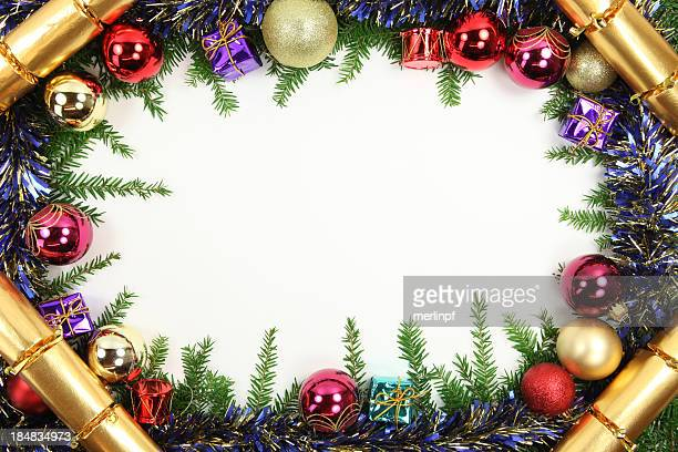 christmas border with crackers - tinsel stock pictures, royalty-free photos & images