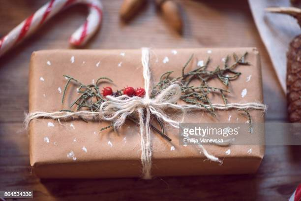 Christmas box on wooden background