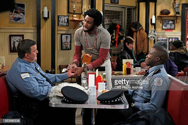 Christmas Break Mike and Carl give Samuel some holiday cheer on MIKE MOLLY Monday Dec 12 on the CBS Television Network