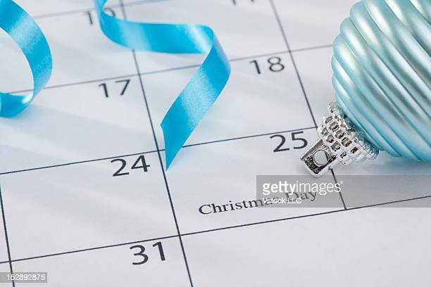 Christmas bulb laying on calendar