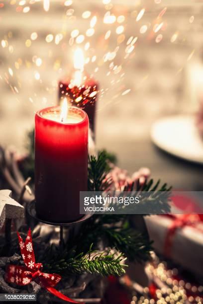 Christmas burning candle with bokeh lighting