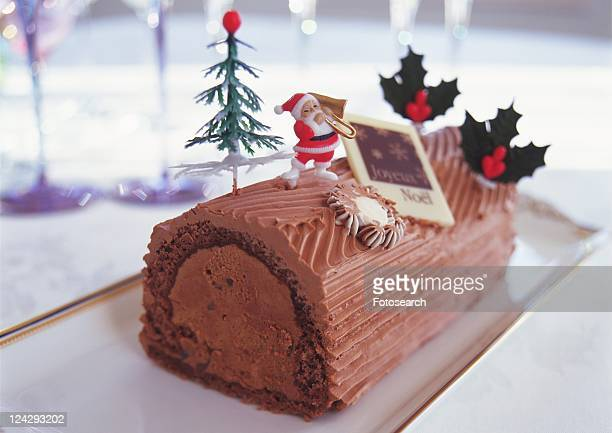 Christmas cake rolled up and covered with chocolate cream, Yolu log